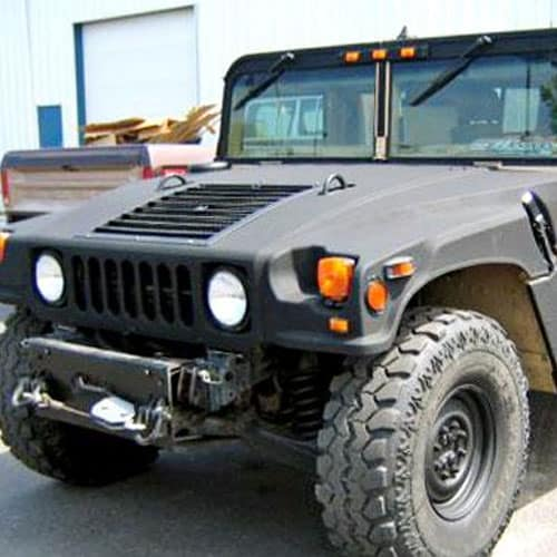 A black military vehicle with Rhino liner products coating the exterior